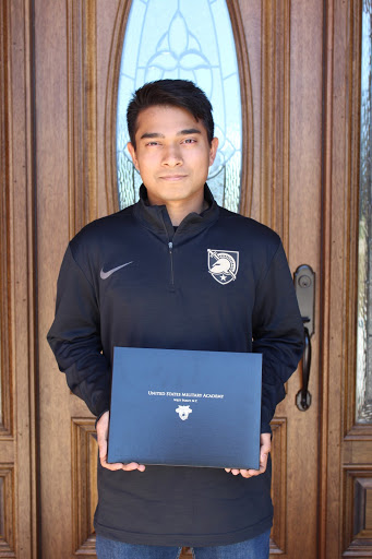 Senior Pai holding his West Point appointment letter